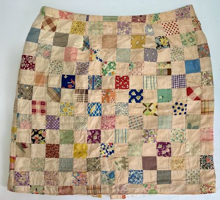 Close up view of patchwork skirt.