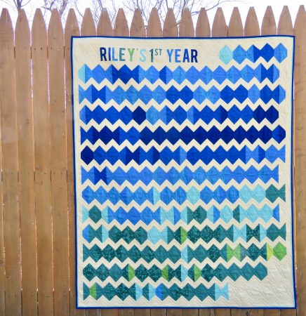 Full quilt front hanging on a fence