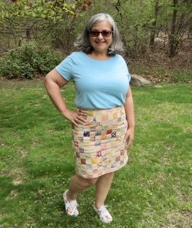 Tina is wearing the skirt she made.