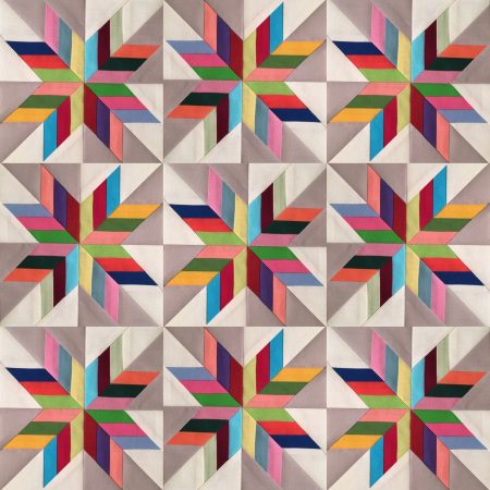 Patchwork star blocks in assorted solid colors.